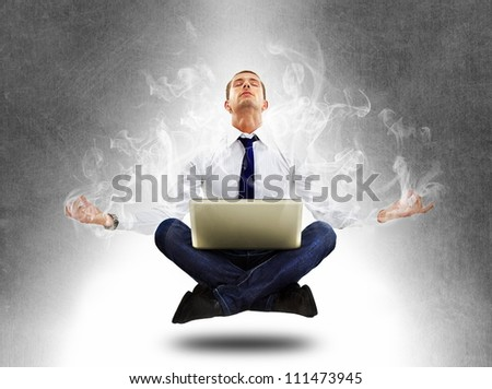 yoga businessman in total concentration with laptop