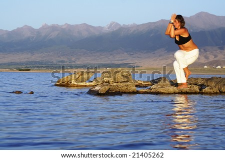 yoga exercise on beach