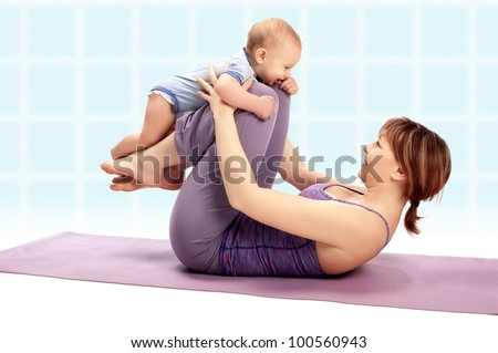 Yoga for woman and child / Mother with her baby boy doing Yoga exercises