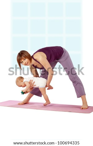 Yoga for woman and child / Mother with her baby doing yoga exercise - stock photo
