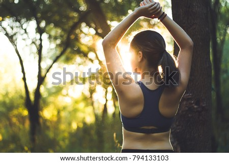 yoga in summer sunset in forest