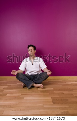 yoga indoor next to a color wall