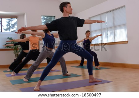 Yoga instructor and students - stock photo