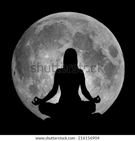 Yoga lotus position silhouette against the full Moon