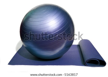 yoga mat and pilates ball isolated on white background