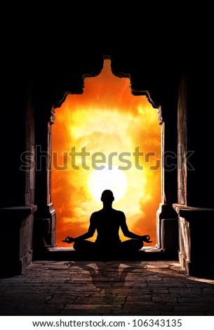 Yoga meditation in lotus pose by man silhouette in old temple arch at    Yoga Meditation Pose Silhouette