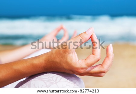 Yoga meditation on the beach, healthy female in peace, soul and mind zen balance concept
