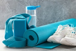 Yoga or fitness items - mat, block, belt and sneakers. Sports Concept