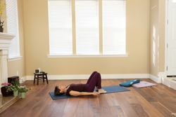Yoga pose back on floor knees bent