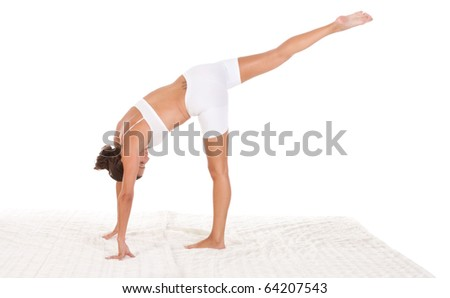 "yoga pose ""Half-Moon"" - female in sport clothes performing exercise"