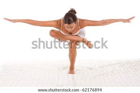"yoga pose ""Standing/Squatting pigeon"" - female in sport clothes performing exercise"