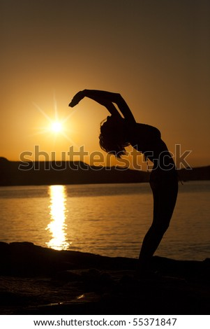 Yoga pose. Sunset silhouette.