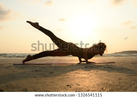 Yoga Poses, Woman practicing Yoga on beach Posing Upward Facing Dog Pose show body organizing over sunset background , Urdhva Mukha Svanasana ,Silhouette Yoga poses