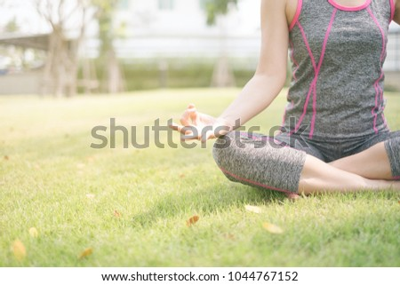 Yoga practice outdoor concept. Woman relax by meditate in park.
