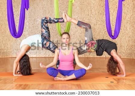 Yoga practicing. Women practicing yoga at health club