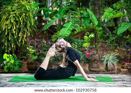 yoga raja kapotasana backward bending posewoman in