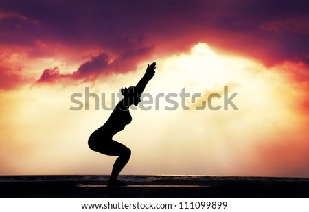 Pose by man in silhouette on the silhouette of a beautiful yoga