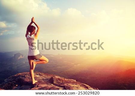yoga woman mountain peak #253029820