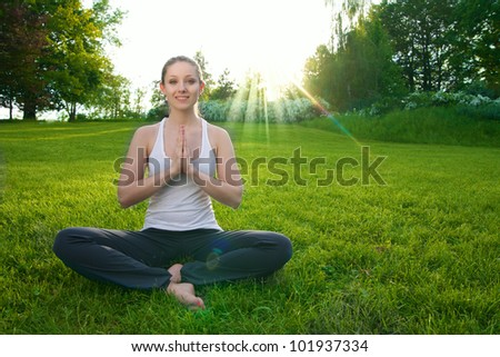 yoga woman on green grass
