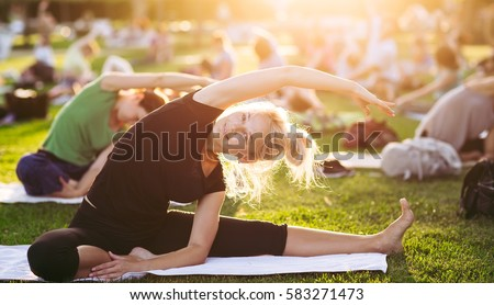 Yoga woman on green grass. #583271473