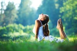 yoga woman on green park