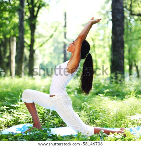 yoga woman on green park