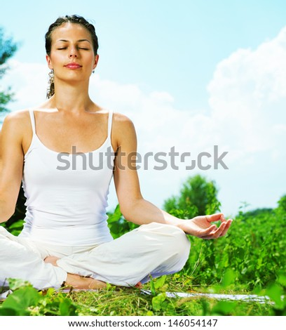 Yoga Young woman doing yoga exercise outdoor