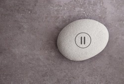 Yoga zen stone with a pause symbol