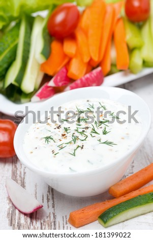 yoghurt sauce with mustard and fresh vegetables, vertical, close-up