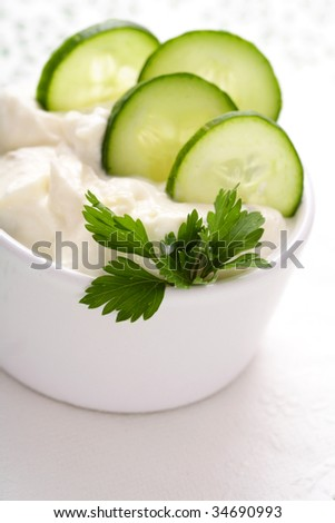 yoghurt with cucumber. Fresh dip of famous Greek taziki with cucumber