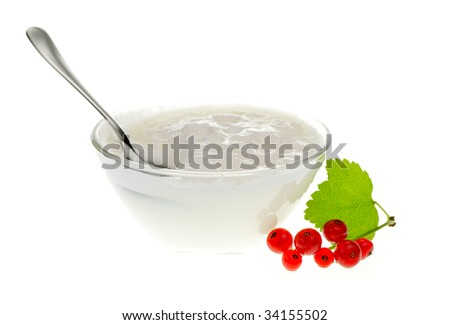 Yogurt bowl with spoon and Redcurrant berries on white background