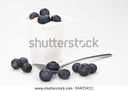 yogurt in plastic box container isolated over white background