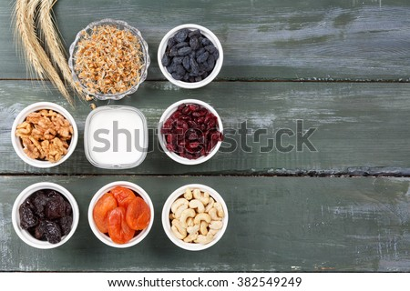 Yogurt on the table with different ingredients