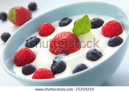 Yogurt with blueberries, raspberries and with strawberries
