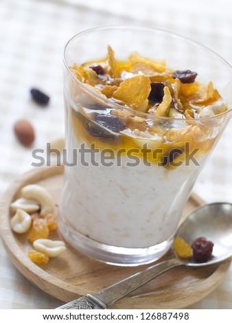 Yogurt with honey and muesli, selective focus