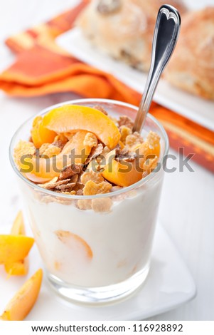 yogurt with muesli and apricot in small glass