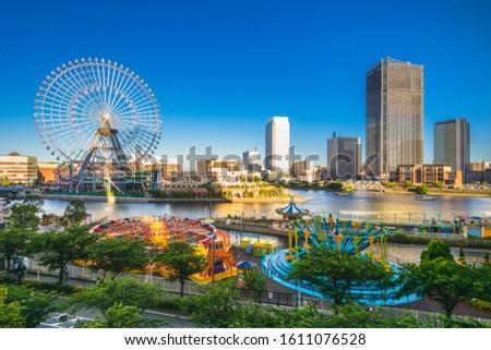 yokohama harbor skyline with ferris wheel, japan stock photo