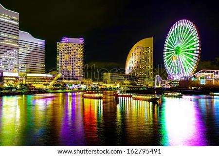 YOKOHAMA, JAPAN - AUGUST 18: Minato Mirai 21 in Yokohama, Japan on August 18, 2012 at night.  It is the central business district of Yokohama, Japan.