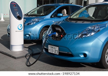 YOKOHAMA, JAPAN - December 4, 2011: A Nissan\'s electric car \'Leaf\' is being charged at the charging station of the company\'s global headquarters located in Yokohama, Japan.
