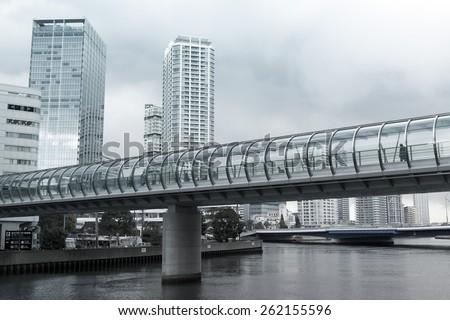 YOKOHAMA, JAPAN - FEB 13 : People walk in modern structure connecting the building on Feb 13,2015 in Yokohama, Japan. Yokohama is the 2nd largest city in Japan after Tokyo with almost 3.7m people.