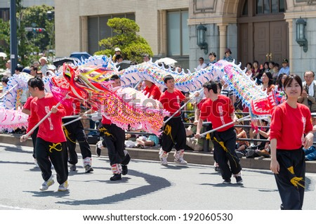 YOKOHAMA, JAPAN - MAY 3, 2014: Chinese students are performing a dragon dance on the street in