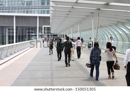 YOKOHAMA, JAPAN - MAY 10: People walk in modern area of the city on May 10, 2012 in Yokohama, Japan. Yokohama is the 2nd largest city in Japan by population after Tokyo with almost 3.7m people.