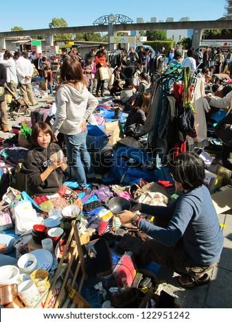 YOKOHAMA,JAPAN - NOVEMBER 4: Shoppers come to flea market at Nissan Stadium on November 4,2012. It is the monthly flea market in Shin-Yokohama.