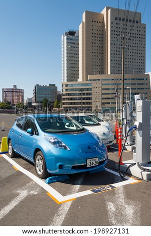 YOKOHAMA, JAPAN - OCTOBER 13, 2013: Electric cars (Nissan Leaf) are parked at a parking lot in Yokohama, Japan. These are used for car sharing which is operated by ORIX Auto Corporation.