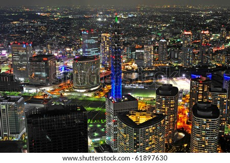 Yokohama night view, the top floor of Yokohama landmark showing the Yokohama city and a beautiful blue tower at night / Yokohama/Nippon Telegraph and Telephone tower
