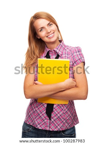 Yong beautiful student girl standing in front of camera holding notebook and smiling on white background