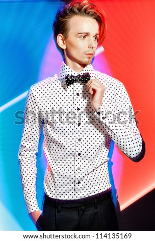 yong elegant style hair men posing on color background .photo