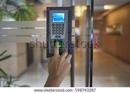 Yong man push down the electronic control machine to access the door