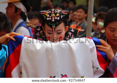 YONGIN - APRIL 18:  A performance of the Traditional Wedding at Korean Folk Village on April 18, 2010 in Yongin, South Korea. Korean Folk Village is a living museum type of tourist attraction.
