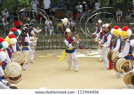 YONGIN, KOREA - AUGUST 6:  The ending of the traditional Korea farmers dance at the Korean folk village in Yongin, Korea on August 6, 2012. The farmers dance occurred to celebrate the harvest in Korea.